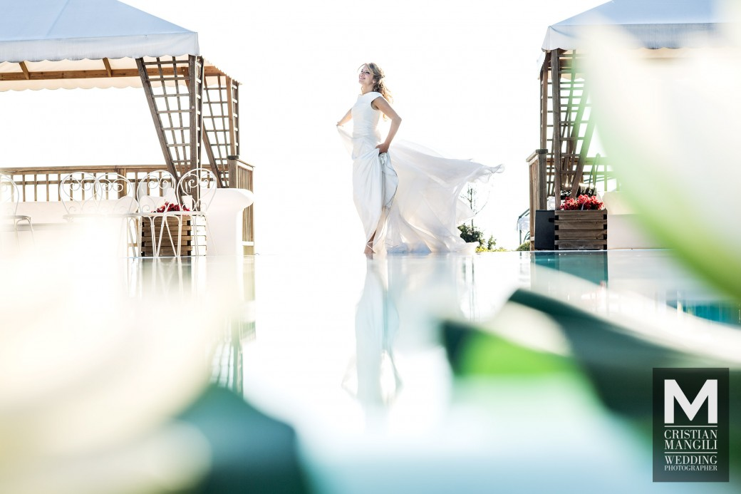 bride-reflecting-into-water-italian-wedding-photographer