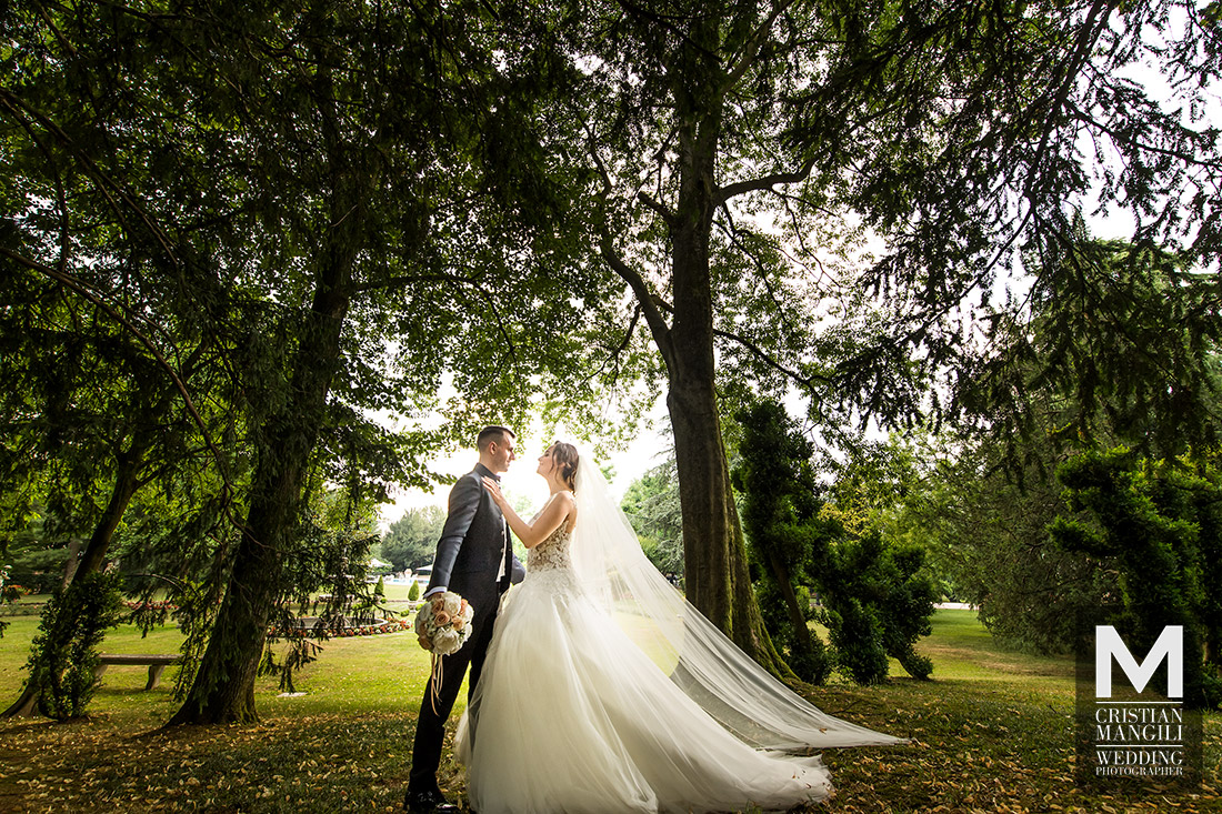 wedding-photography-bride-and-groom-kissing-park