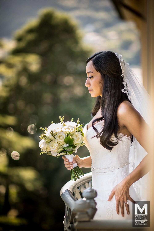 wedding-photographer-italy-lake-como-beautiful-bride-balcony-hotel