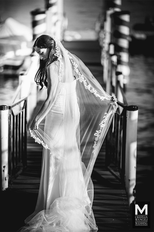 wedding-photographer-bride-lake-como-pier-italy