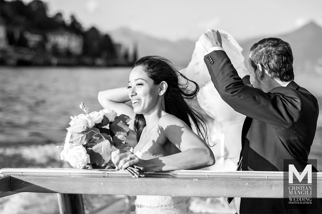 wedding-photography-romantic-scenery-bride-and-groom-on-boat-lake-como-italy