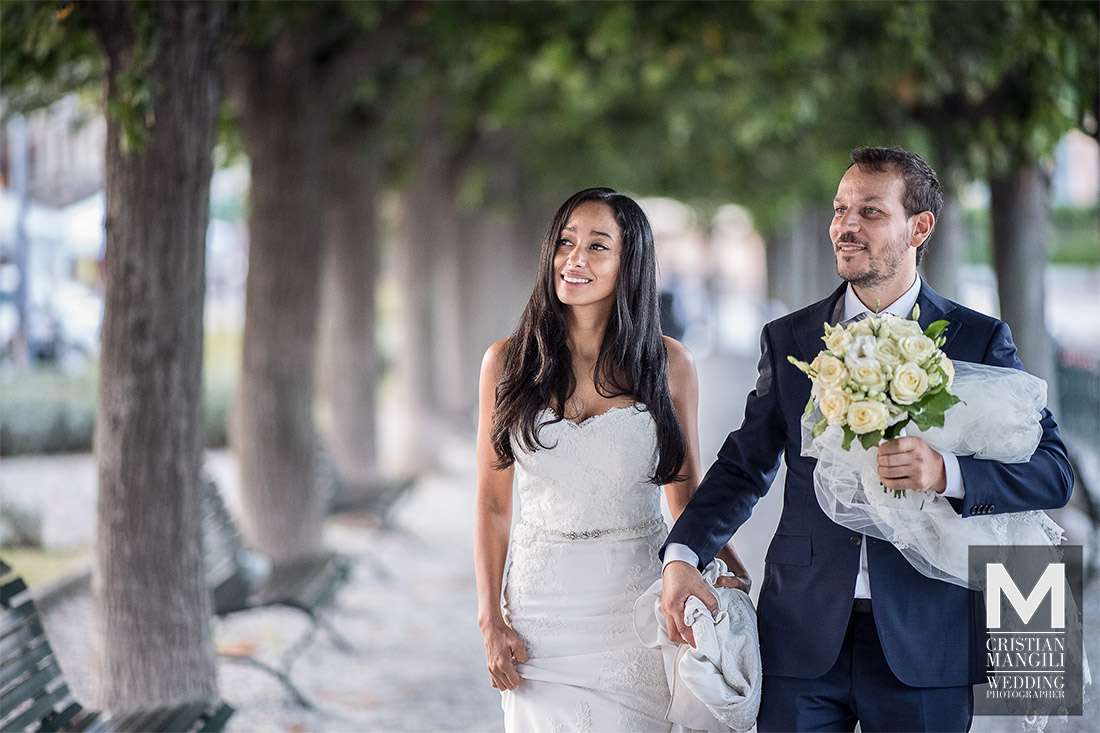 wedding-photographer-lake-como-italy-groom-walking-under-trees