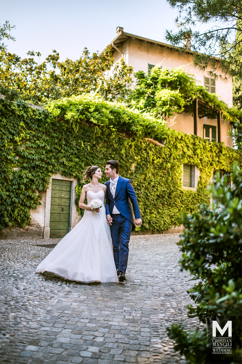 newlyweds-walking-in-varenna-como-lake-wedding-photography
