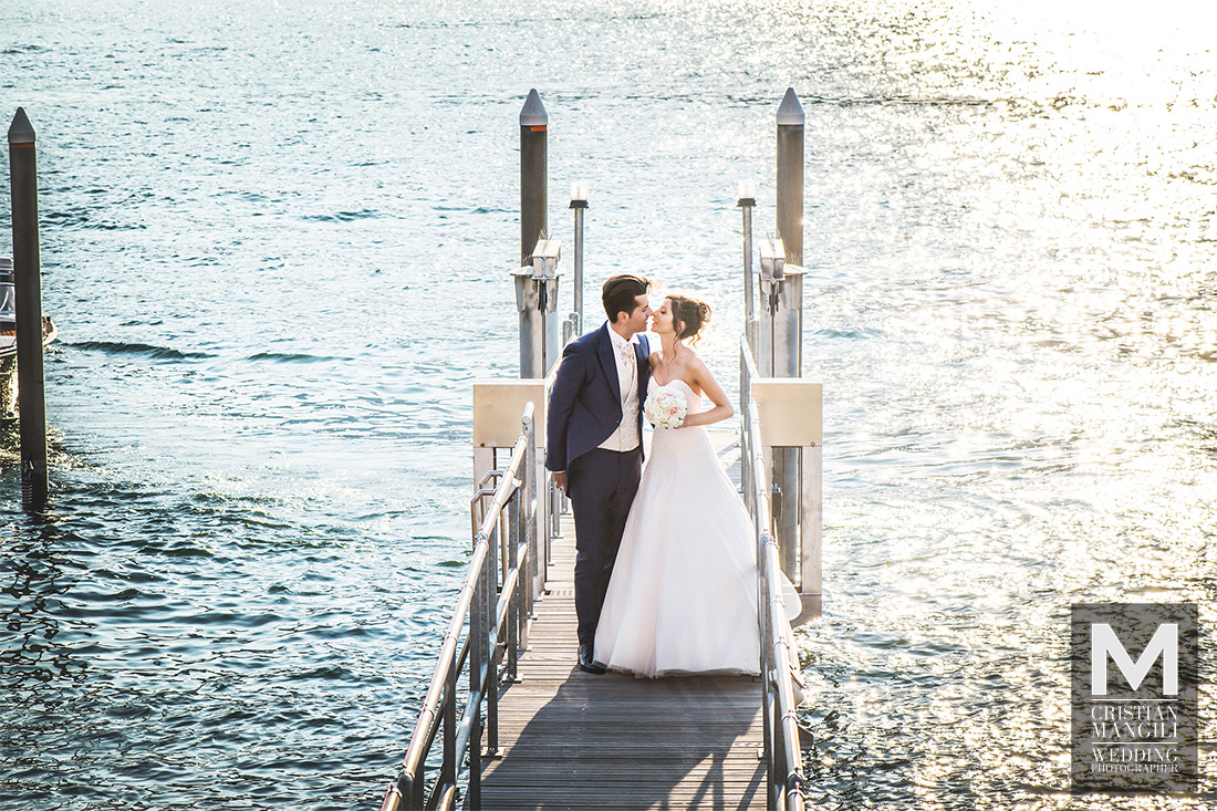 wedding-kissing-como-lake-shore
