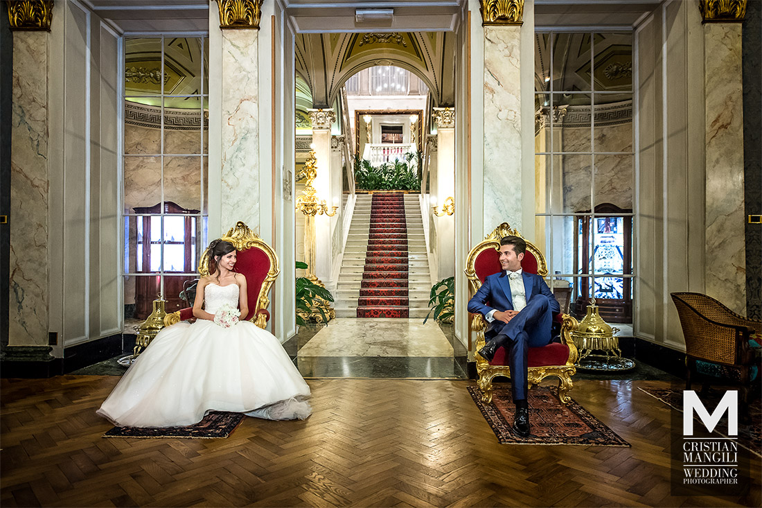 bride-and-groom-sitting-in-villa-serbelloni-luxury-wedding-in-italy